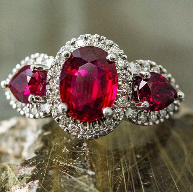 Oval and pear shape 3 stones ruby ring